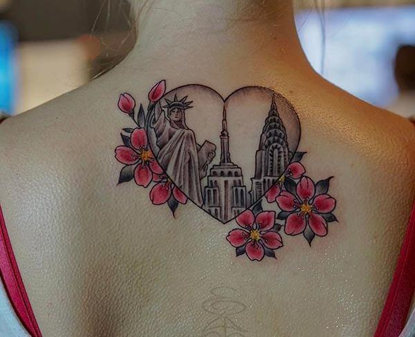 good-looking adorable tattoo design on back for girls and women