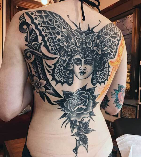 thrilling black and white tattoo on back for girls