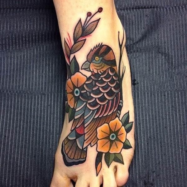 enthralling bird tattoo design on feet for girls and women