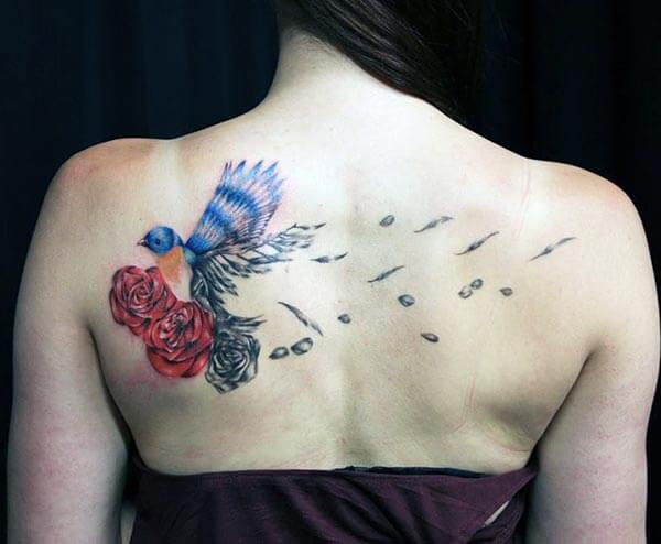 stunning and eye-catchy bird tattoo design on back for girls