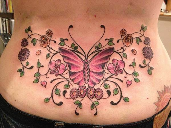 charming butterfly tattoo design on the lower back for Girls