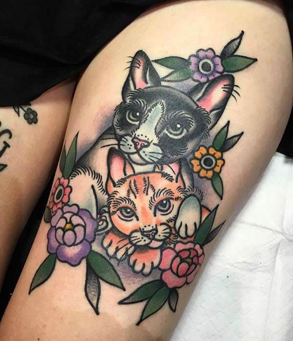 attractive and cute cat tattoo design on thigh for Girls