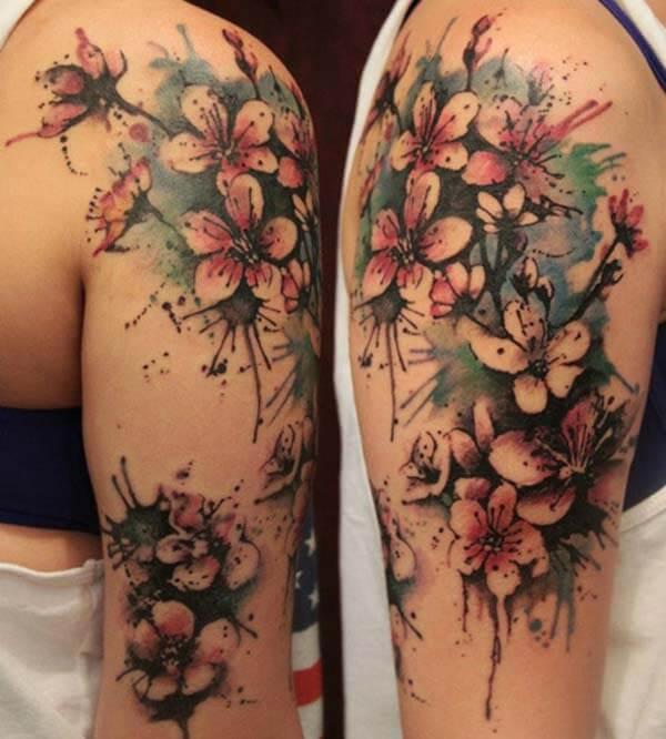 breathtaking watercolour cherry blossom tattoo design on shoulder for Women