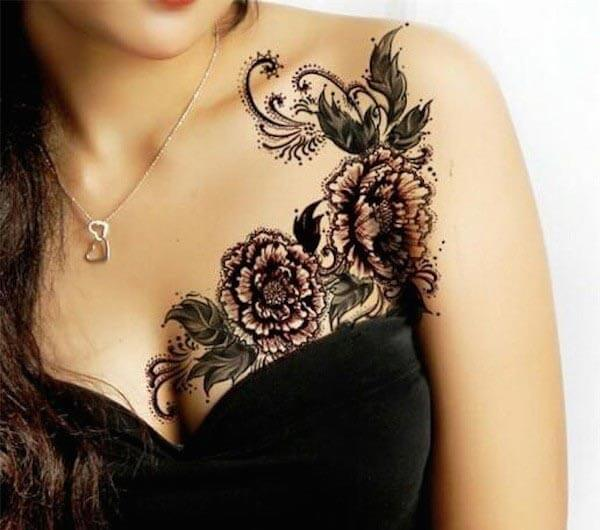 An intricate floral vine tattoo on side chest for girls