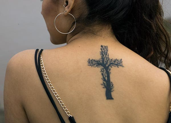 An awesome creative cross tattoo design on back shoulder for girls and ladies