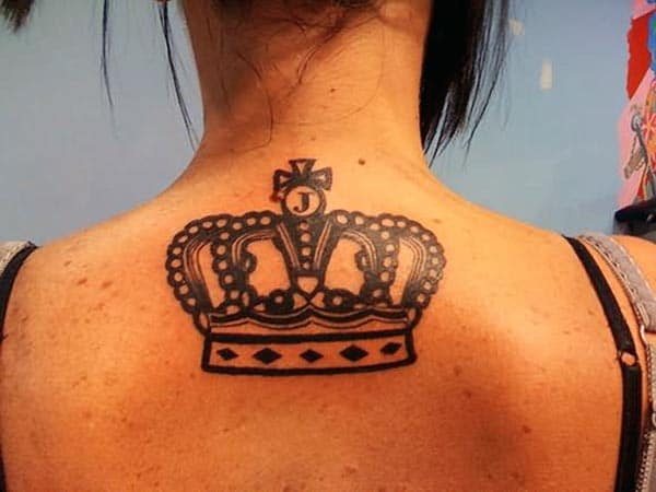 An eye-catchy bold black crown tattoo design on back for Ladies