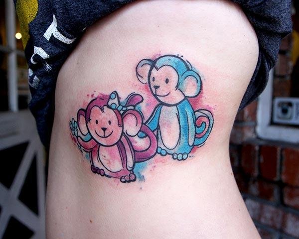 A lovely vibrant monkey tattoos on side belly for women