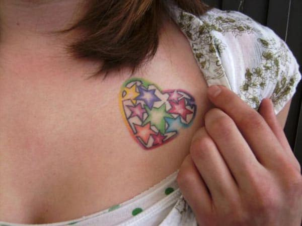 A charming cute heart tattoo design on front shoulder for girls