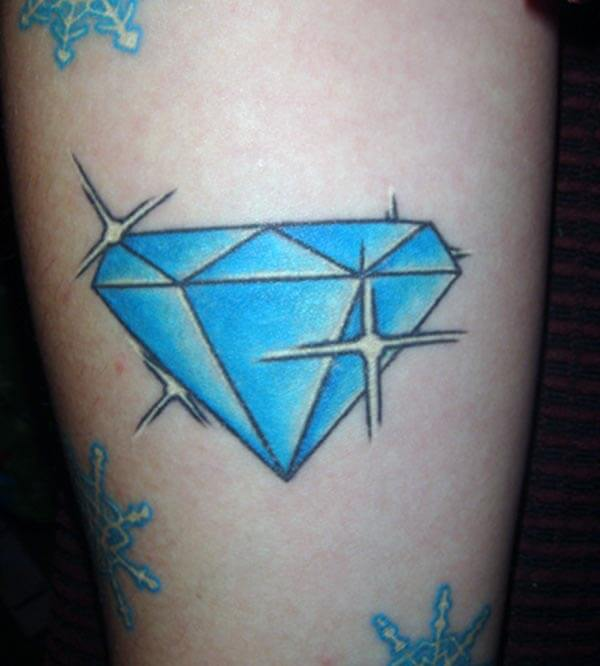 A sparkling blue diamond tattoo on arm for Ladies