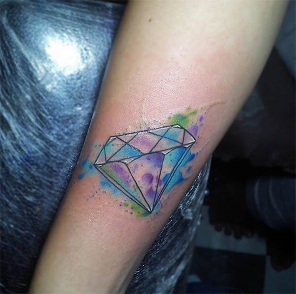 Awesome watercolor diamond tattoo design on forearm for Girls