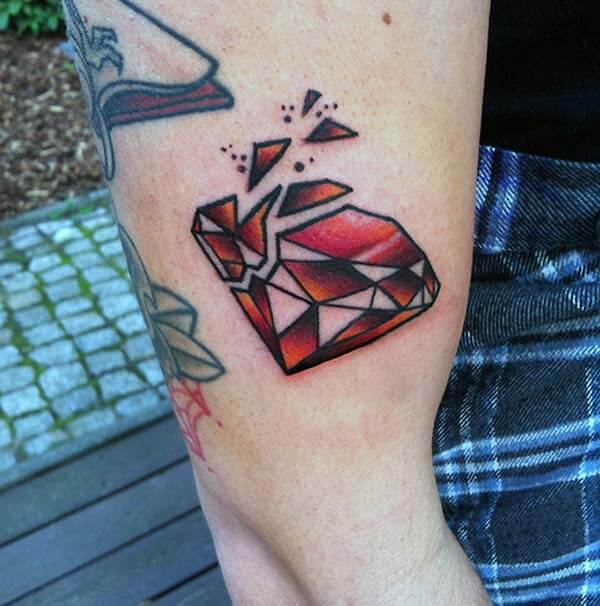 A broken red diamond tattoo design on arm for Girls