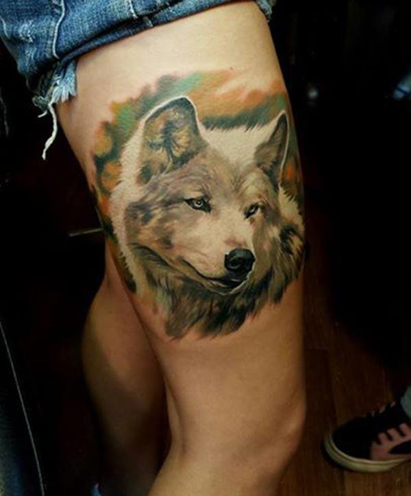 An eye-catchy dog tattoo design on thighs for Girls