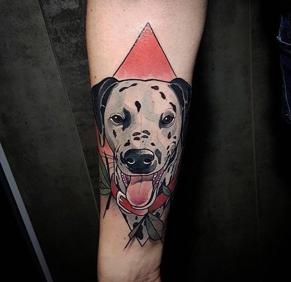An awe-inspiring dog tattoo design on forearm for Women