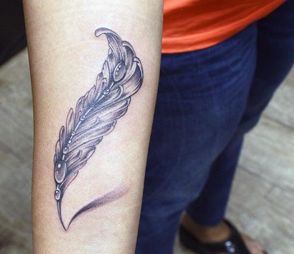 An impressive feather tattoo design on forearm for Ladies