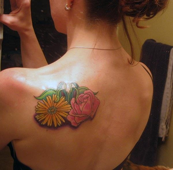 A beautiful flower tattoo design on back shoulder for Girls
