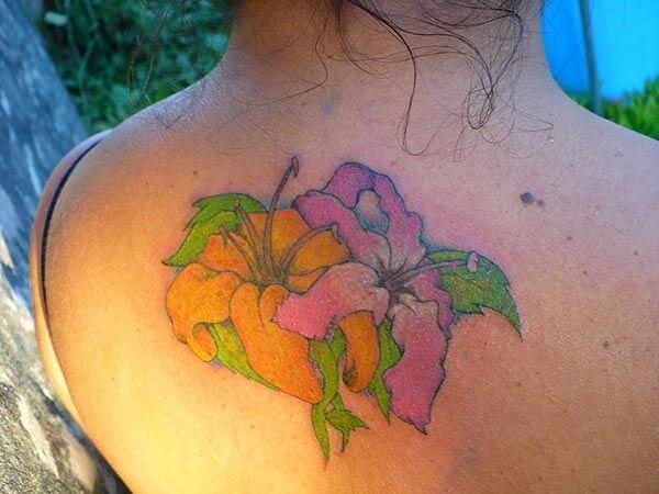A lovely flower tattoo design on back for Girls and women