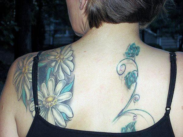 A magnificent flower tattoo design on back shoulder for Women