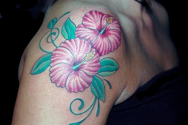 An impressive flower tattoo design on shoulder for Girls and women