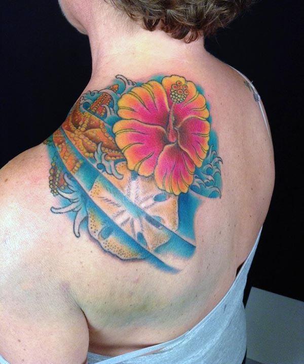 A vibrant eye popping flower tattoo design on back shoulder for Ladies