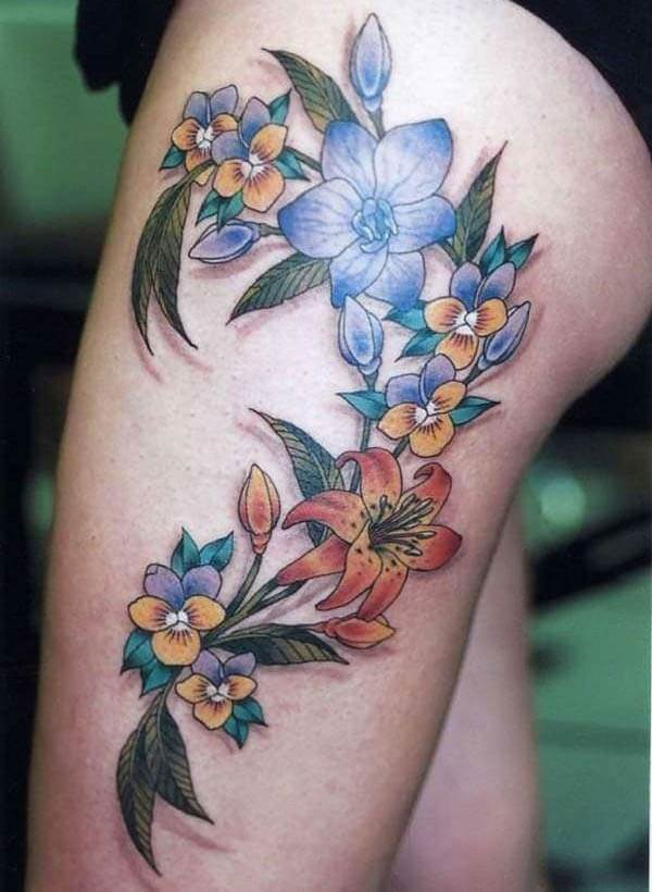 A marvelous flower tattoo design on thigh for Women and girls