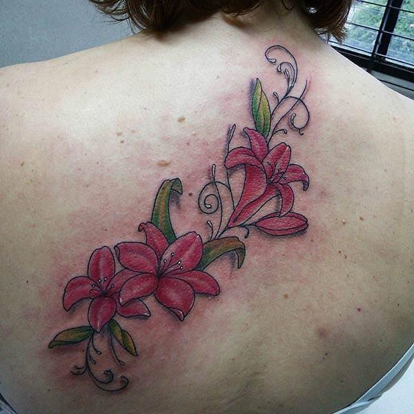 An appealing flower tattoo design on back for Girls