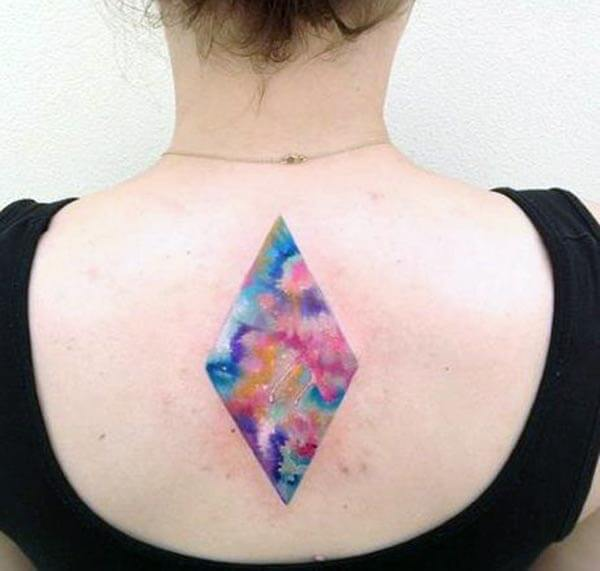 A multi hue geometric tattoo design on back for Girls