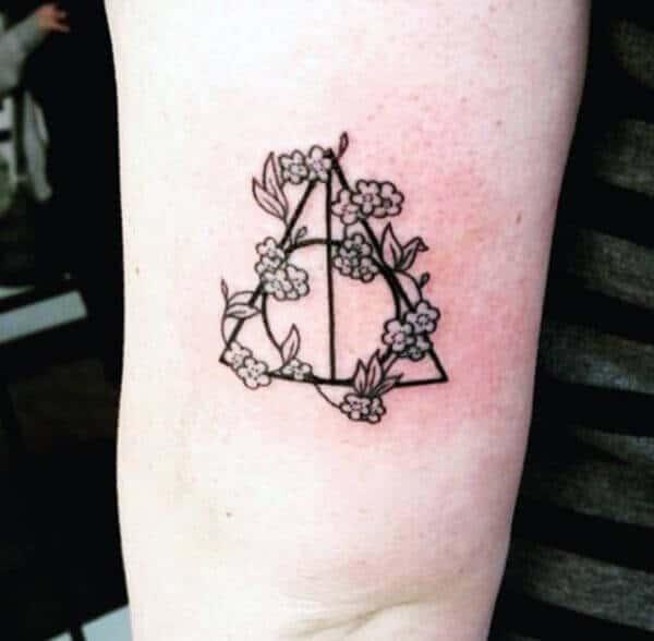 A ornamental geometric tattoo design on arm for girls