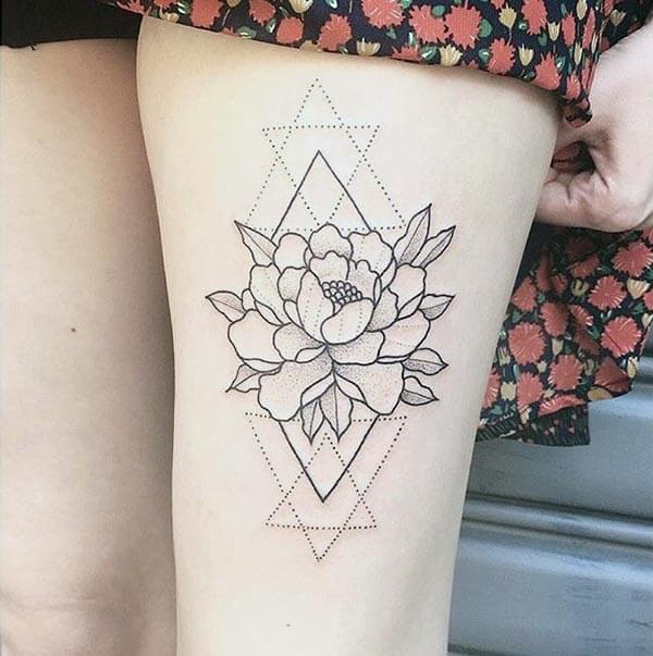An aesthetic geometric tattoo design on thigh for ladies