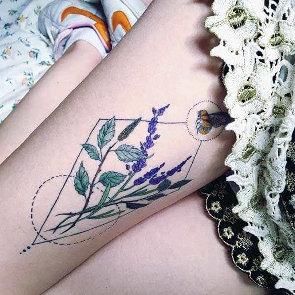 A delightful geometric tattoo design on thigh for Ladies