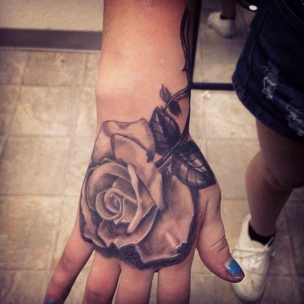 An eye-popping hand tattoo design for girls