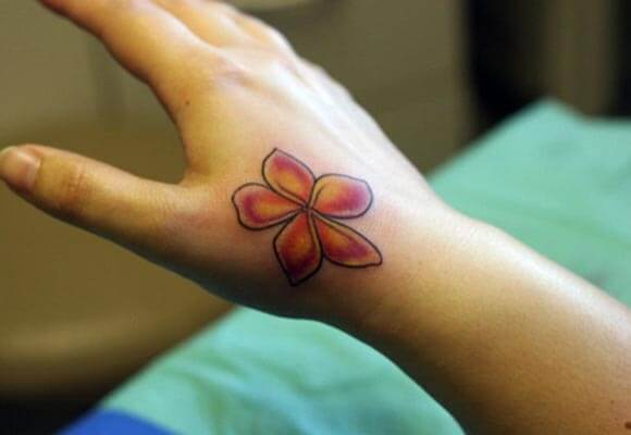 A simple lovely hand tattoo design for women