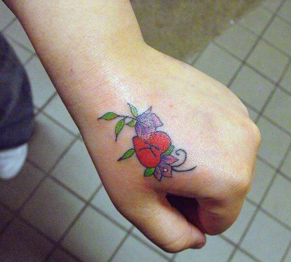 A sweet hand tattoo design for women