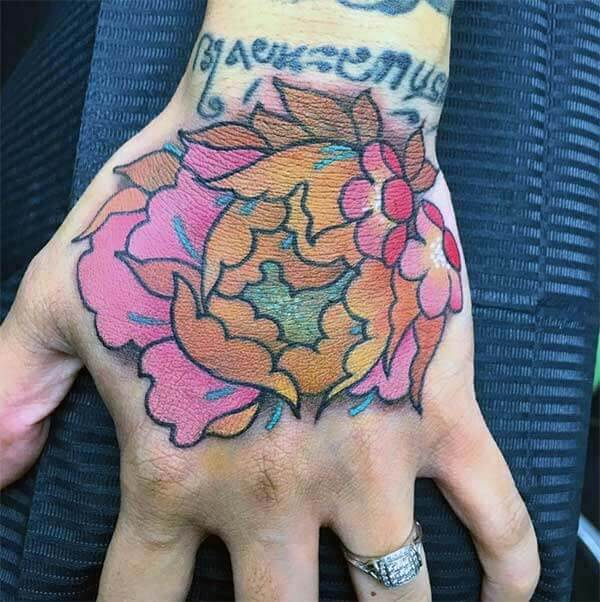 An eye-catchy hand tattoo design for ladies
