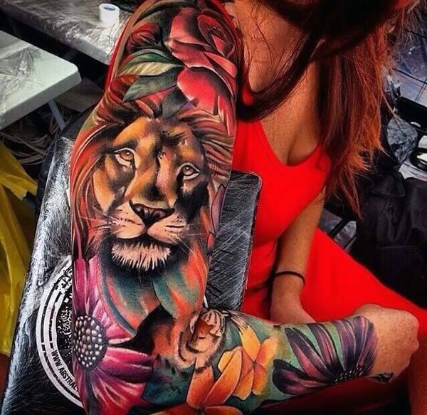 A jaw-dropping cool lion tattoo design on full arm for women