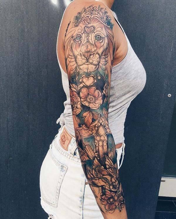 A mind blowing lion tattoo design on full arm for ladies