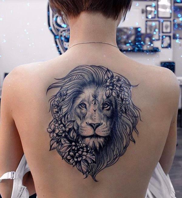 A captivating lion tattoo design on back for girls