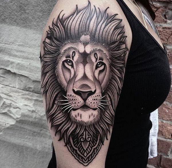 A stunning lion tattoo design on shoulder for girls and women