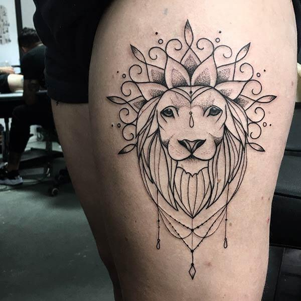 A graceful lion tattoo design on thigh for Women