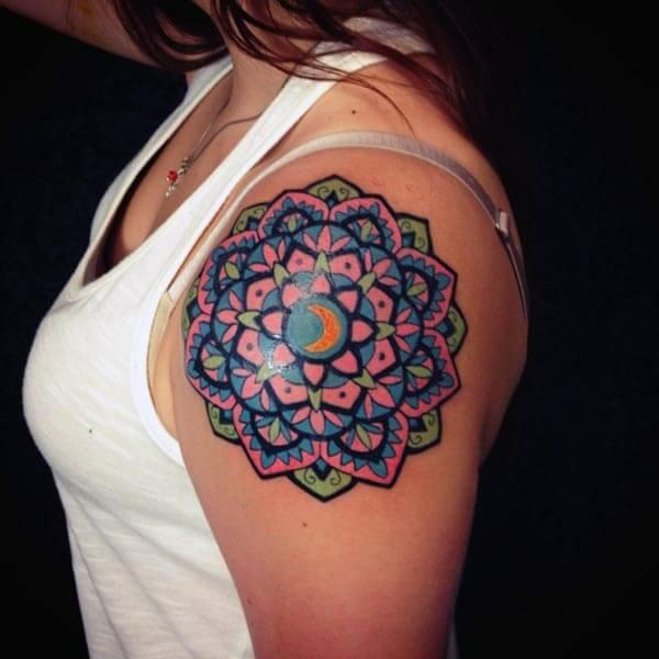 A vibrant mandala tattoo design on shoulder for Ladies