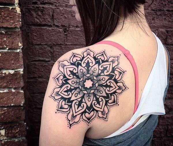 A catchy mandala tattoo design on back shoulder for Girls