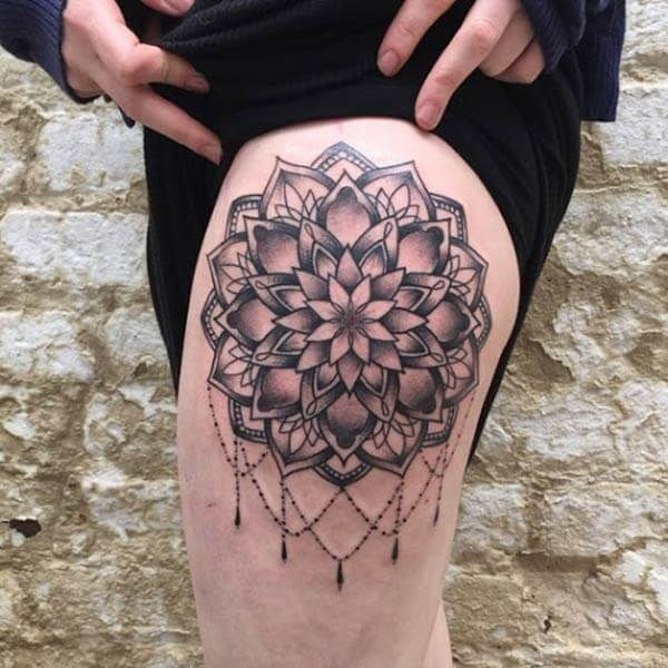 A jaw dropping mandala tattoo design on thigh for ladies