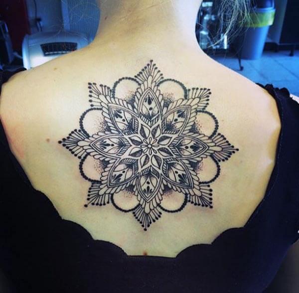 An enchanting mandala tattoo design on back for women
