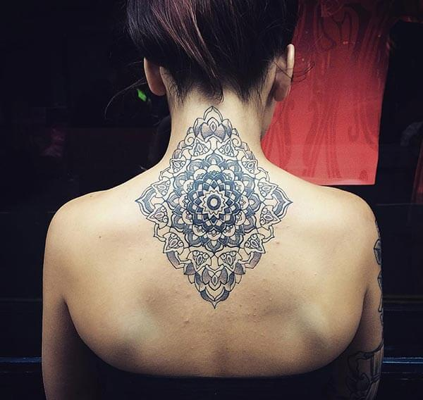 A magical mandala tattoo design on back neck for Ladies