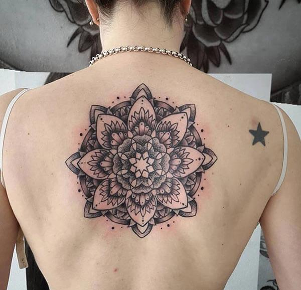 An attractive mandala tattoo design on back for ladies