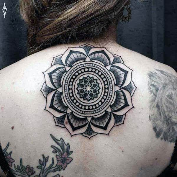 A magnificent mandala tattoo design on back for women