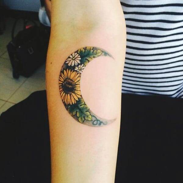 A gorgeous moon tattoo design on forearm for Women