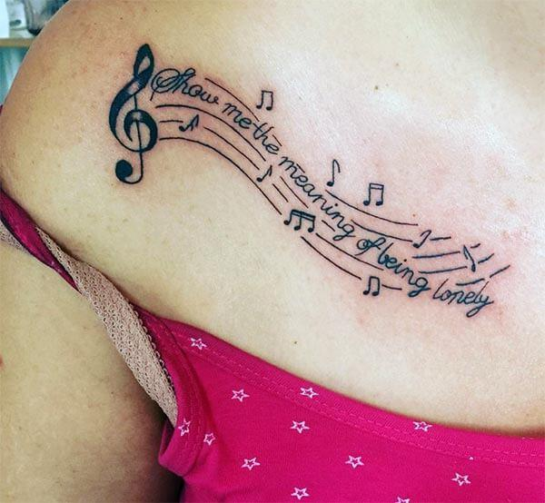 A lovely music tattoo design on back for Girls and women