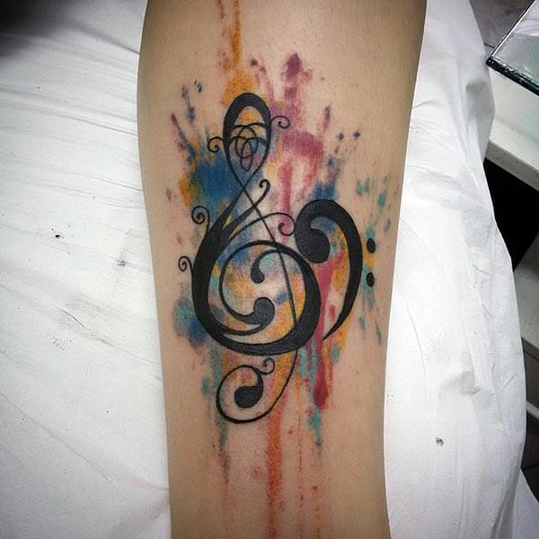 An alluring music tattoo design on arm for girls