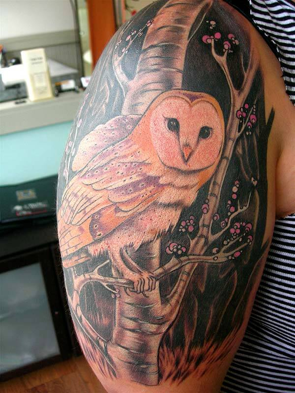 A magnificent owl tattoo design on upper arm for ladies