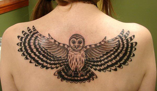 An attractive owl tattoo design on back for girls